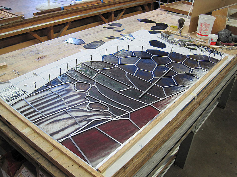 Inserting stained glass pieces and lead came